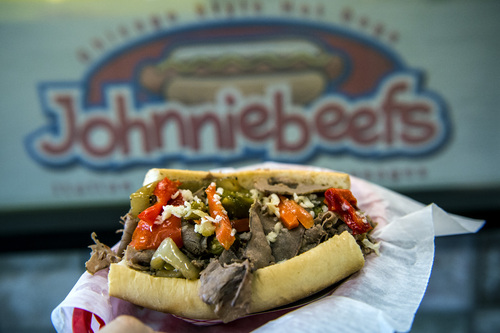 Chris Detrick  |  The Salt Lake Tribune The Italian Beef Sandwich ($6.99) with seasoned roast beef on a French roll and sweet peppers and hot giardiniera at Johnniebeefs in Cottonwood Heights.