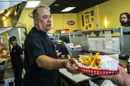 Chris Detrick  |  The Salt Lake Tribune Owner John Carrsquilla serves up some fries at Johnniebeefs in Cottonwood Heights.