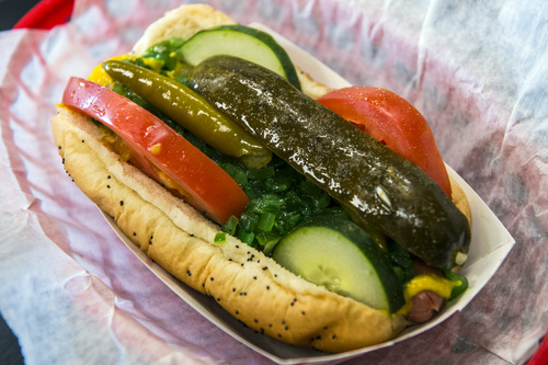 Chris Detrick   |   The Salt Lake Tribune A Chicago Dog ($3.99) with mustard, onions, green relish, cucumbers, tomatoes, sport peppers, pickle spear, and celery salt at Johnniebeefs†in Cottonwood Heights.