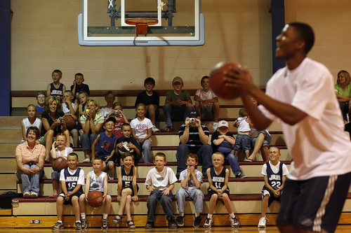 Chris Detrick  |  Tribune file photo As students from Altamont watch from the stands, Utah Jazz rookie Morris Almond demonstrates how to shoot a free throw in Altamont Wednesday, June 18, 2008.