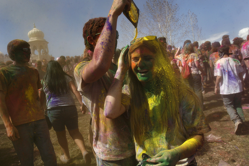 Scott Sommerdorf   |  The Salt Lake Tribune People cover each other in colors at the 2013 Festival of Colors - Holi Celebration - takes place at the Krishna Temple in Spanish Fork, Saturday, March 30, 2013. The festival celebrates Holi, the announcement of the arrival of spring.