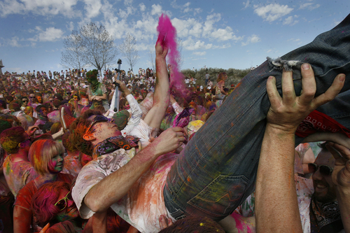 "Scott Sommerdorf   |  The Salt Lake Tribune ""Crowd surfing"" at the 2013 Festival of Colors - Holi Celebration - at the Krishna Temple in Spanish Fork, Saturday, March 30, 2013. The festival celebrates Holi, the announcement of the arrival of spring."