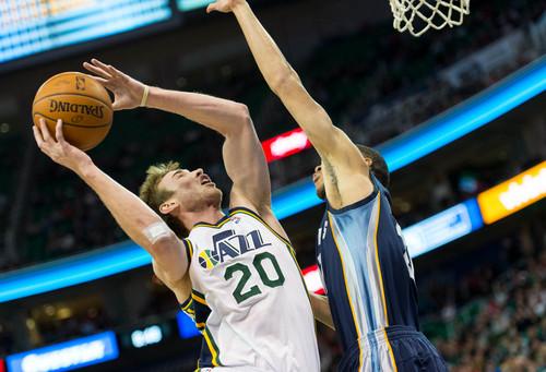 Trent Nelson  |  The Salt Lake Tribune Utah Jazz guard Gordon Hayward (20) shoots as the Utah Jazz face the Memphis Grizzlies, NBA basketball at EnergySolutions Arena in Salt Lake City, Wednesday, March 26, 2014.