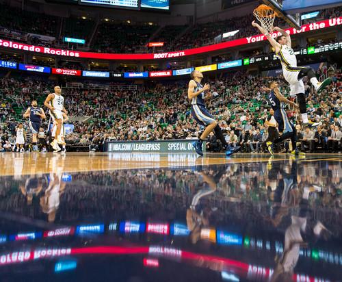 Trent Nelson  |  The Salt Lake Tribune Utah Jazz guard Gordon Hayward (20) dunks the ball as the Utah Jazz face the Memphis Grizzlies, NBA basketball at EnergySolutions Arena in Salt Lake City, Wednesday, March 26, 2014.