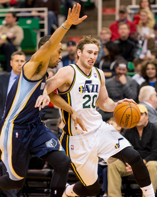 Trent Nelson  |  The Salt Lake Tribune Utah Jazz guard Gordon Hayward (20) drives past Memphis Grizzlies guard Courtney Lee (5) as the Utah Jazz face the Memphis Grizzlies, NBA basketball at EnergySolutions Arena in Salt Lake City, Wednesday, March 26, 2014.
