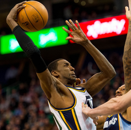 Trent Nelson  |  The Salt Lake Tribune Utah Jazz forward Jeremy Evans (40) puts up a shot as the Utah Jazz face the Memphis Grizzlies, NBA basketball at EnergySolutions Arena in Salt Lake City, Wednesday, March 26, 2014.
