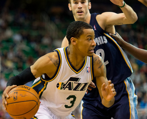 Trent Nelson  |  The Salt Lake Tribune Utah Jazz guard Trey Burke (3) drives past Memphis Grizzlies guard Nick Calathes (12) as the Utah Jazz face the Memphis Grizzlies, NBA basketball at EnergySolutions Arena in Salt Lake City, Wednesday, March 26, 2014.