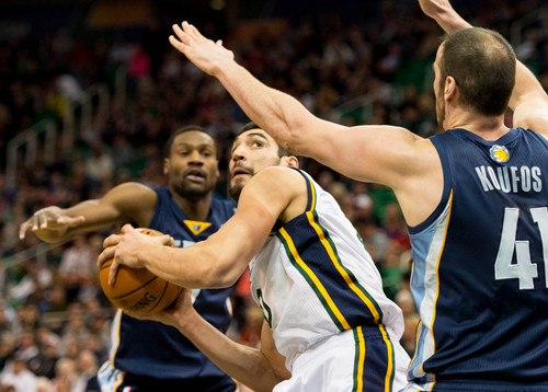 Trent Nelson  |  The Salt Lake Tribune Utah Jazz center Enes Kanter (0) look to shoot, defended by Memphis Grizzlies guard Tony Allen (9) and Memphis Grizzlies center Kosta Koufos (41) as the Utah Jazz face the Memphis Grizzlies, NBA basketball at EnergySolutions Arena in Salt Lake City, Wednesday, March 26, 2014.