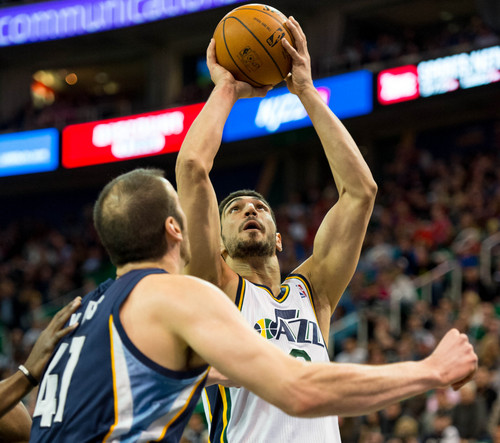 Trent Nelson  |  The Salt Lake Tribune Utah Jazz center Enes Kanter (0) shoots over Memphis Grizzlies center Kosta Koufos (41) as the Utah Jazz face the Memphis Grizzlies, NBA basketball at EnergySolutions Arena in Salt Lake City, Wednesday, March 26, 2014.