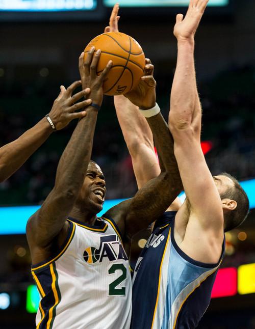 Trent Nelson  |  The Salt Lake Tribune Utah Jazz forward Marvin Williams (2) shoots over Memphis Grizzlies center Kosta Koufos (41) as the Utah Jazz face the Memphis Grizzlies, NBA basketball at EnergySolutions Arena in Salt Lake City, Wednesday, March 26, 2014.