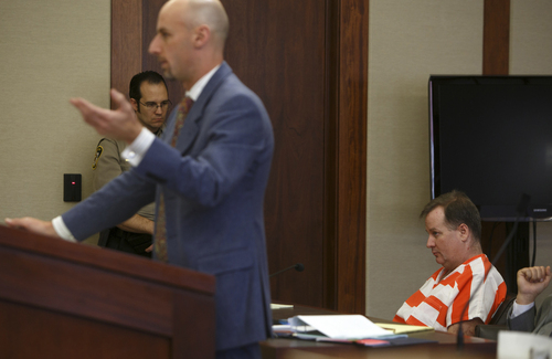 Richard Jones, right, who stands accused of murdering his wife and stepson in 2011, listens as his defense attorney, Jeremy Delicino, left, questions a witness during Jones' preliminary hearing in 5th District Court Wednesday, March 26, 2014 in St. George, Utah. (AP Photo/The Spectrum & Daily News,  Jud Burkett)