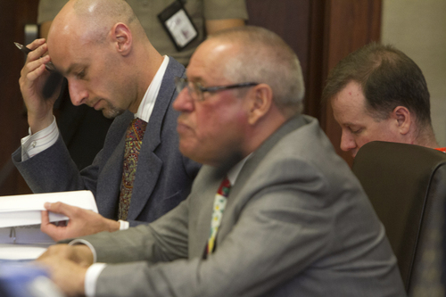 Richard Jones, right, shakes his head as he sits with his attorneys, Jeremy Delicino, left, and Stephen McCaughey and listens while Washington City Police Department Lt. Vance Bithell details the confession Jones gave from a hospital bed shortly after Jones' wife Michelle and step son Owen Christopher Ellis were murdered in 2011 during Jones' preliminary hearing in 5th District Court Wednesday, March 26, 2014 in St. George, Utah. (AP Photo/The Spectrum & Daily News,  Jud Burkett)