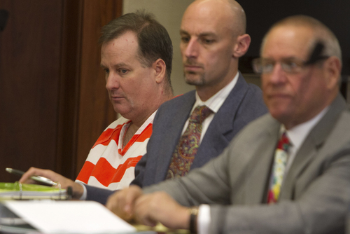 Richard Jones, left, who stands accused of murdering his wife and stepson in 2011, listens along with his defense attorneys, Jeremy Delicino and Stephen McCaughey, right, as the prosecution presents it's case during Jones' preliminary hearing in 5th District Court Wednesday, March 26, 2014 in St. George, Utah. (AP Photo/The Spectrum & Daily News,  Jud Burkett)