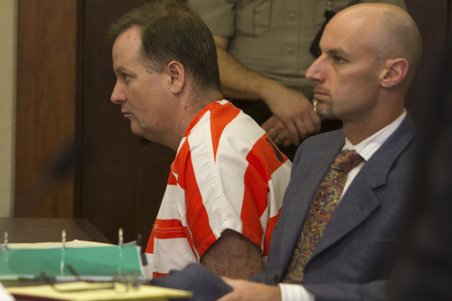 Richard Jones, left, who stands accused of murdering his wife and stepson in 2011, listens along with his defense attorney, Jeremy Delicino as the prosecution presents it's case during Jones' preliminary hearing in 5th District Court Wednesday, March 26, 2014 in St. George, Utah. (AP Photo/The Spectrum & Daily News,  Jud Burkett)