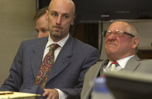 "Richard Jones, left, and his attorneys, Jeremy Delicino, and Stephen McCaughey, right, react as the recording of the call that Jones' wife Michelle Jones made to 911shortly before her death in 2011 in which she tells a dispatcher , ""My husband just shot my son. He's got a gun, he's going to hurt me now"" is played during Jones' preliminary hearing in 5th District Court Wednesday, March 26, 2014 in St. George, Utah. (AP Photo/The Spectrum & Daily News,  Jud Burkett)"