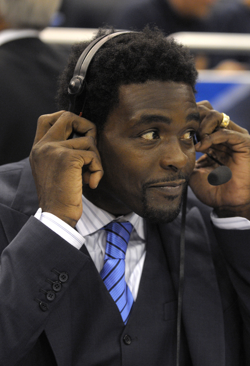 FILE - Chris Webber works as an analyst on the sideline during the first half of an NBA basketball game between the Orlando Magic and Chicago Bulls in Orlando, Fla., in this March 19, 2012 file photo. BracketRacket loves his new tournament-themed ad for Burger King. Webber, who played 15 years in the NBA and now works as a TV analyst, watched the Wolverines lose to  Louisville in last year's title game from a private suite.  (AP Photo/Phelan M. Ebenhack, File)