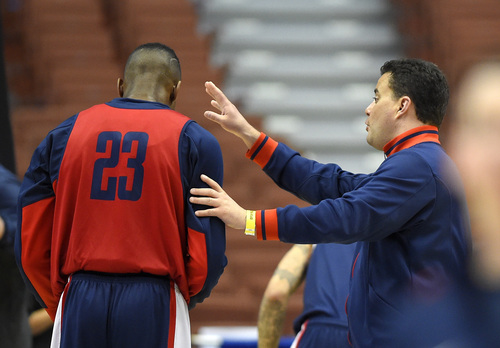 Arizona head coach Sean Miller, right, talks with forward Rondae Hollis-Jefferson during practice at the NCAA college basketball tournament, Wednesday, March 26, 2014, in Anaheim, Calif. Arizona is scheduled to play San Diego State on Thursday in a regional semifinal. (AP Photo/Mark J. Terrill)