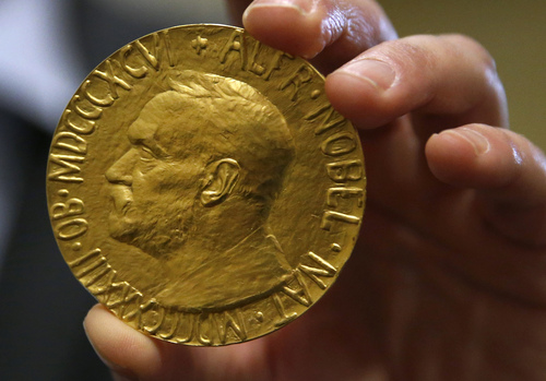 Bidder Ole Bjorn Fausa, of Norway, holds the 1936 Nobel Peace Prize in Baltimore, Thursday, March 27, 2014, the second Nobel Peace Prize ever to come to auction. It was won by an anonymous telephone bidder for $950,000. The recipient was Argentina's foreign minister, Carlos Saavedra Lamas, who was honored for his role in negotiating the end of the Chaco War between Paraguay and Bolivia. (AP Photo/Patrick Semansky)