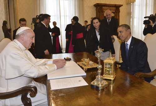 Pope Francis meets President Barack Obama at the Vatican Thursday, March 27, 2014. President Barack Obama is holding a historic first meeting with Pope Francis, the pontiff that the president views as a kindred spirit on issues of economic inequality and the poor. Obama arrived at the Vatican Thursday morning amid the pomp and tradition of the Catholic Church, making his way to greet the pope after a long slow procession. (AP Photo/Gabriel Bouys, Pool)