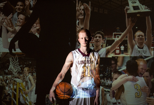 Keith Johnson | The Salt Lake Tribune  All-state basketball MVP T.J. Haws, stands in front of a projector splashing images onto him from his 4 high school basketball championships, March 20, 2014 in Salt Lake City.