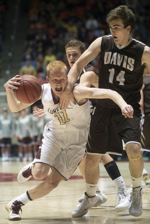 Keith Johnson | The Salt Lake Tribune  Lone Peak's TJ Haws drives past Davis' Matt Morrell (14) during the Utah high school 5A semi-finals at the Huntsman Center in Salt Lake City, March 7, 2014. Bountiful advances to the final.
