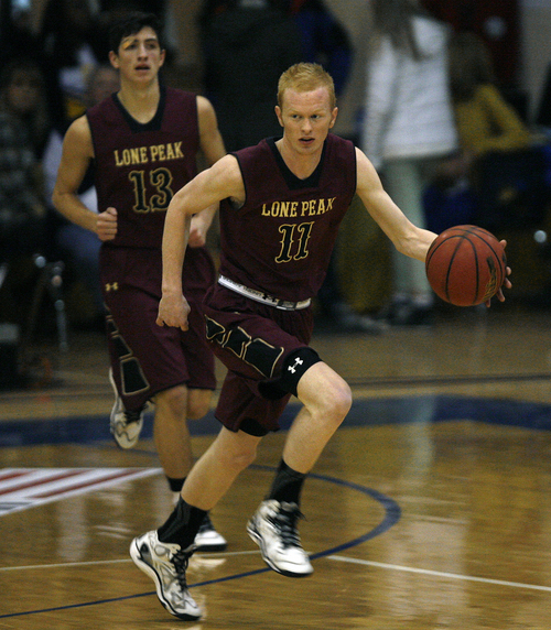 Scott Sommerdorf   |  The Salt Lake Tribune Lone Peak guard TJ Haws during second half play. Lone Peak defeated Bishop O'Connell 49-46 on TJ Haws' 3-point buzzer-beater at Orem High School, Friday December 6, 2013.