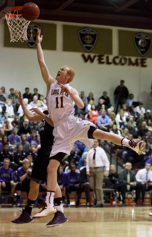 Trent Nelson  |  The Salt Lake Tribune Lone Peak's TJ Haws shoots a layup as Lone Peak hosts Riverton High School basketball Wednesday January 9, 2013 in Highland.