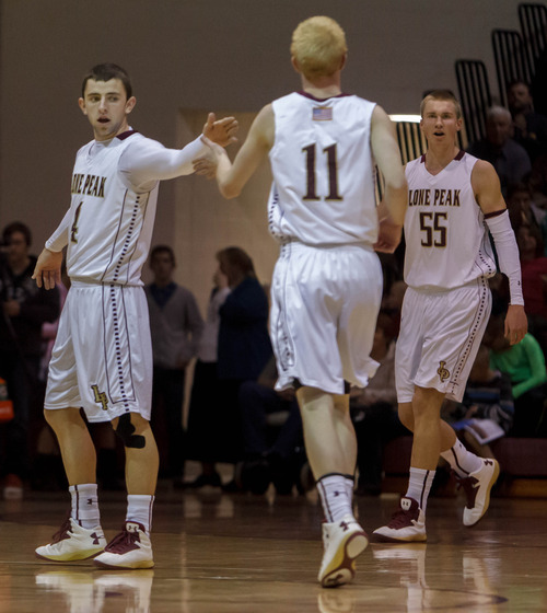 Trent Nelson  |  The Salt Lake Tribune Lone Peak's Nick Emery, TJ Haws and Eric Mika celebrate a substantial lead as Lone Peak hosts Riverton High School basketball Wednesday January 9, 2013 in Highland.