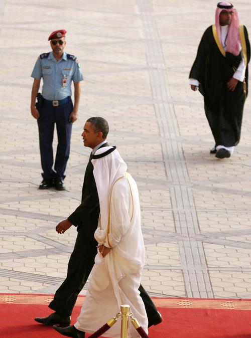 U.S. President Barack Obama is welcomed by Governor of Riyadh Prince Khalid Bandar bin Abdul-Aziz Al-Saud on arriving in Riyadh, Saudi Arabia, on Friday, March 28, 2014. (AP Photo/Hasan Jamali)