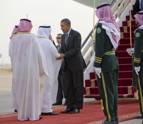 President Barack Obama is greeted by members of the Saudi delegation upon his arrival on Air Force One at King Khalid International airport in Riyadh, Saudi Arabia, Friday, March 28, 2014. President Barack Obama is in Saudi Arabia to reassure the key Gulf ally that his commitment to the Arab world isn't wavering. (AP Photo/Pablo Martinez Monsivais)