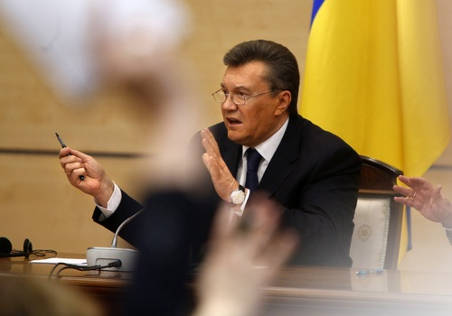 Journalists Ukraine's fugitive President Viktor Yanukovych speaks at a news conference as journalists raise arms to ask questions in Rostov-on-Don, a city in southern Russia about 1,000 kilometers (600 miles) from Moscow, Friday, Feb. 28, 2014. Yanukovych has pledged to fight on for the country's future. (AP Photo/Pavel Golovkin)
