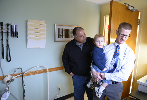 Rick Egan  |  The Salt Lake Tribune Tony Gregory, who will be the physician's assistant in the new Mid-Valley Health Clinic, holds his son Parke while touring the facility after a ribbon-cutting ceremony Thursday.