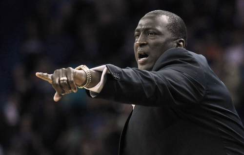 Utah Jazz head coach Tyrone Corbin calls to his team against the New Orleans Pelicans in the first half of an NBA basketball game in New Orleans, Friday, March 28, 2014. (AP Photo/Bill Haber)