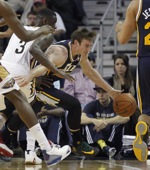 Utah Jazz guard Gordon Hayward (20) tries to get around New Orleans Pelicans guard Anthony Morrow (3) in the first half of an NBA basketball game in New Orleans, Friday, March 28, 2014. (AP Photo/Bill Haber)