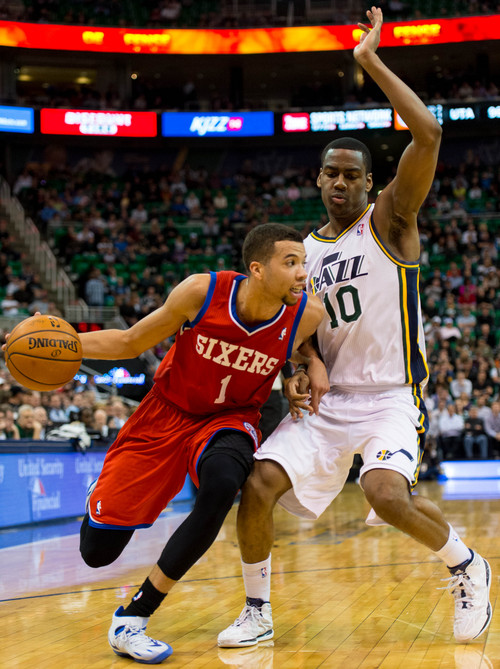 Trent Nelson  |  The Salt Lake Tribune Philadelphia 76ers point guard Michael Carter-Williams (1) defended by Utah Jazz point guard Alec Burks (10) as the Utah Jazz host the Philadelphia 76ers, NBA basketball at EnergySolutions Arena in Salt Lake City, Wednesday February 12, 2014.