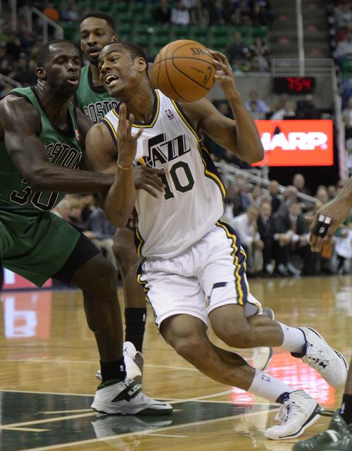 Rick Egan  | The Salt Lake Tribune   Utah Jazz point guard Alec Burks (10) drives on Boston Celtics power forward Brandon Bass (30), in NBA action, at the EnergySolutions Arena, Monday, February 24, 2014.