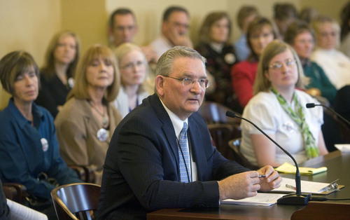 Al Hartmann   |  The Salt Lake Tribune  Martell Menlove, then deputy superintendent of the Utah State Office of Education, speaks before the Senate Education Committee in  2011. Now superintendent, he announced his retirement Friday.