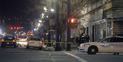 Al Hartmann     The Salt Lake Tribune Salt Lake City Police investigate the scene at 300 South and West Temple at 6:30 a.m. Friday morning March 28 where there was an officer involved shooting. Two officers were wounded and the suspect was killed.