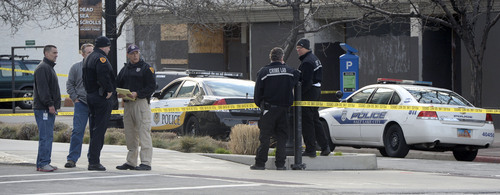 Al Hartmann     The Salt Lake Tribune Salt Lake Police investigate the scene at 300 South and West Temple Friday morning March 28 where there was an officer involved shooting. Two officers were wounded and the suspect was killed.