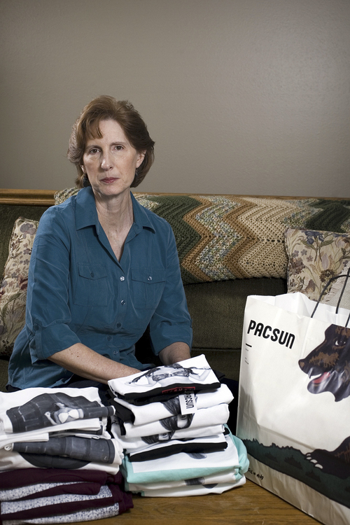 Mark Johnston  |  Associated Press file photo Judy Cox in February sits next to a stack of T-shirts with what she believes are pornographic designs in Orem, Utah. Cox purchased the entire stock of T-shirts from the PacSun store in Orem believing their display broke Orem's decency code.