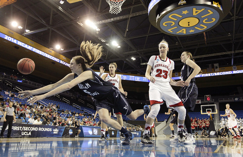 BYU's Jennifer Hamson (5) goes after a loose ball as Nebraska's Emily Cady (23) watches during the second half of a second-round game in the NCAA women's college basketball tournament on Monday, March 24, 2014, in Los Angeles. BYU won 80-76. (AP Photo/Jae C. Hong)