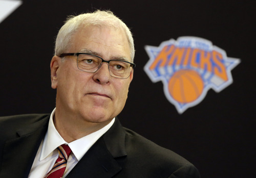 New York Knicks new team president Phil Jackson listens to a question during a news conference where he was introduced, at New York's Madison Square Garden, Tuesday, March 18, 2014. Jackson signed a five-year contract that will reportedly pay him at least $12 million annually and said he will spend significant time in New York.(AP Photo/Richard Drew)