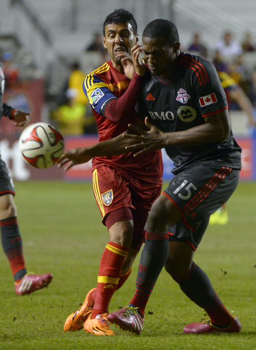 Rick Egan  |  The Salt Lake Tribune  Real Salt Lake midfielder Javier Morales (11) and Toronto FC defender Doneil Henry (15) go after the ball, in MLS action, Real Salt Lake vs. Toronto FC, at Rio Tinto Stadium, Saturday, March 29, 2014
