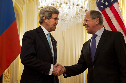 U.S. Secretary of State John Kerry, left, shakes hands with Russian Foreign Minister Sergey Lavrov before the start of their meeting at the Russian Ambassador's residence about the situation in Ukraine, in Paris Sunday March 30, 2014. Kerry traveled to Paris for a last minute meeting with Lavrov. (AP Photo/Jacquelyn Martin, Pool)