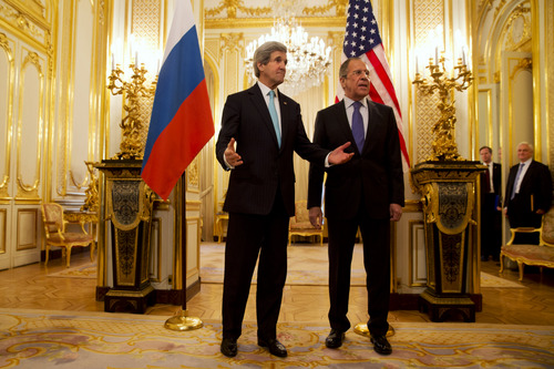 U.S. Secretary of State John Kerry, left, gestures as he and Russian Foreign Minister Sergey Lavrov meet at the Russian Ambassador's Residence to discuss Ukraine, in Paris Sunday March 30, 2014. Kerry traveled to Paris for a last minute meeting with Lavrov. (AP Photo/Jacquelyn Martin, Pool)