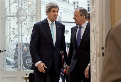 U.S. Secretary of State John Kerry, left, is greeted by Russian Foreign Minister Sergey Lavrov at the Russian Ambassador's Residence to discuss the situation in Ukraine, in Paris, Sunday March 30, 2014. Kerry traveled to Paris for a last minute meeting with Lavrov. (AP Photo/Jacquelyn Martin, Pool)