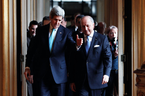 U.S. Secretary of State John Kerry, left, and his French counterpart Laurent Fabius arrive for a meeting at the Quai d'Orsay, in Paris, Sunday, March 30, 2014. After a week of travel in the Mideast, Kerry changed course and arrived in Paris Saturday for talks with his Russian counterpart on the Ukraine crisis. (AP Photo/Thibault Camus)