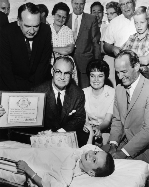 Tribune file photo  Six-year-old Grant Hunsaker Jr., was the first patient admitted to the  new University of Utah Medical Center on July 10, 1965. Presenting him with a  commemorative plaque were, from left, Utah Governor Calvin L. Rampton; Kenneth B.  Castleton, M.D. dean of the U of U School of Medicine; Mrs. G.K. Hunsaker, Grant's  mother; and Vernon L. Harris, University Hospital's first administrator.