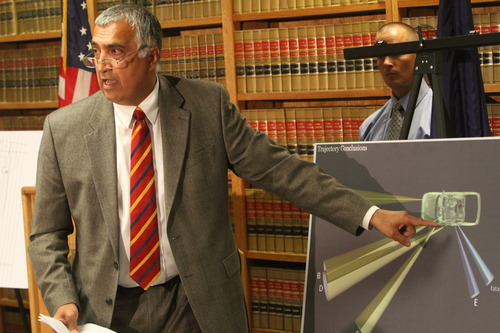 Rick Egan  | The Salt Lake Tribune  Salt Lake County District Attorney Sim Gill points out the angle of the fatal bullet, while discussing the findings of the investigation into the Danielle Willard fatal shooting, Thursday, August 8, 2013. Mike Powell, West Valley Police is on the right.