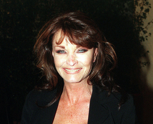 """FILE - In Oct. 6 1998 file photo,  British actress Kate O'Mara poses for photographers.  Actress Kate O'Mara, best known for her role in the 1980s soap opera """"Dynasty,"""" has died at the age of 74. Her agent Phil Belfield said O'Mara died Sunday, March 30, 2014,  in a nursing home in southern England after a short illness. The actress, who began her television career in the 1960s, became a household name for playing Alexis Colby's scheming sister Cassandra """"Caress"""" Morrell in """"Dynasty."""" She also appeared in the original run of British series """"Doctor Who"""" and BBC drama """"Howards' Way."""" (AP Photo/PA, Michael Walter, File) UNITED KINGDOM OUT NO SALES NO ARCHIVE"""
